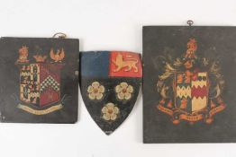 A group of three antique coach/carriage plaques, coats of arms, the largest 30.5 cm x 25 cm.
