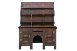 "An Arts & Crafts style quarter-sawn oak kneehole dresser, the rack bearing the legend: ""Confide"