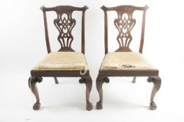 """A pair of Geo III carved and pieced mahogany """"Chippendale"""" style side chairs with bow-shaped"""