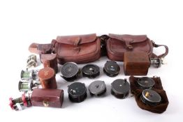 A collection of early 20th century and later fishing reels, to include examples by A.J. Bernard &
