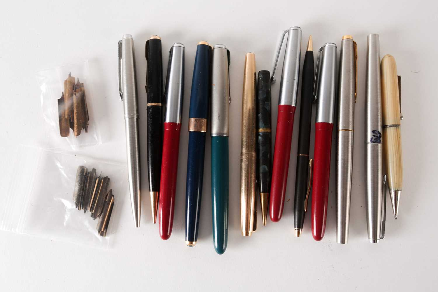 Three Platignum iridium fountain pens with 14 K gold nibs, together with a Parker fountain pen in