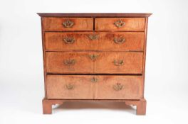 An early 18th century walnut chest of drawers with crossbanded quarter veneered above Two short over
