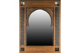 An Indian giltwood mirror, with beaded border decoration flanking a shaped dome plate, early 20th