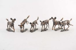 David Tomlinson: a set of six bronze figures of African Hunting Dogs, named differently as 'Leader',