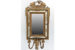 A 19th-century wall mounted girandole mirror with painted white panel surrounds and three candle
