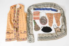 Of theatrical costume interest, a mid-century silk and embroidered long waistcoat, 100 cm long,