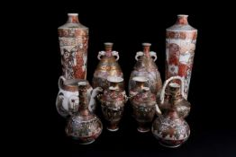 A Japanese Meiji period Satsuma globular vase with applied elephant head handles. Painted with a