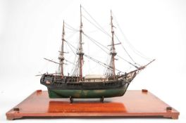 A scale model of the full-rigged HM Bounty with painted detail. Housed in a glazed display case.