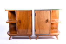 A pair of mid 20th century figured walnut bedside cabinet bookcases, each radiused at one end and
