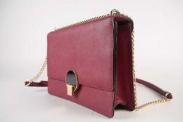 Vivienne Westwood; A burgundy leather Balmoral-style handbag, with leather and chain strap handle.