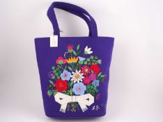 A Lulu Guiness embroidered wool felt handbag, the front decorated with a bouquet of flowers in