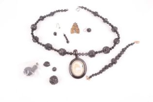 A Victorian black beaded necklace, with oval pendant with vacant photograph frame (lacking glass),