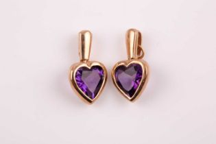 A pair of 9ct yellow gold and amethyst heart-shaped pendants, marked to suspension loops, hearts