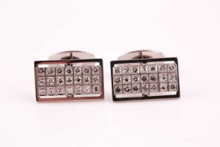 A pair of diamond cluster cufflinks, the rectangular plaques pave set with twenty one round