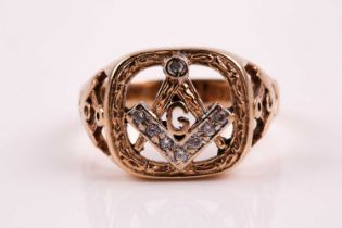 A 9ct gold and diamond Masonic ring, the large openwork cushion-shaped central plaque with a pair of