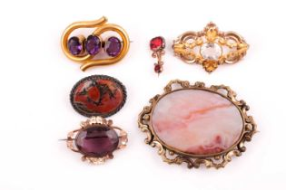 A group of five various 19th-century brooches, including amethyst, agate and paste in gilt and