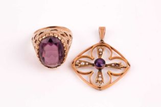 An Edwardian amethyst and split pearl pendant, the cruciform centre with collet set amethyst