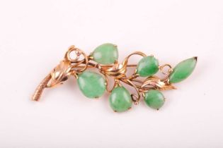 A 14ct yellow gold and jadeite brooch, of foliate design, stamped 14K.Condition report: 6.8g