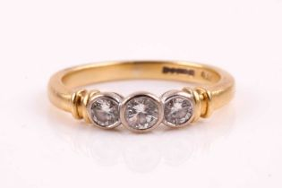 An 18ct yellow gold and diamond ring, set with three graduated round brilliant-cut diamonds of
