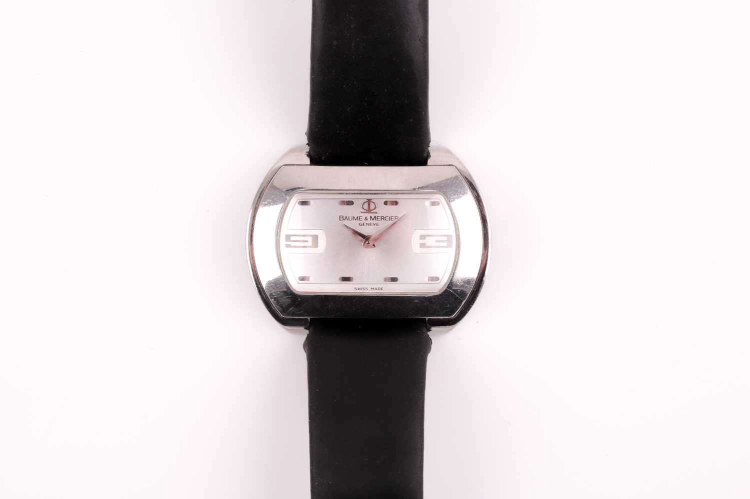 A Baume & Mercier ladies stainless steel oval wristwatch, the silvered dial with larger 3 and 9