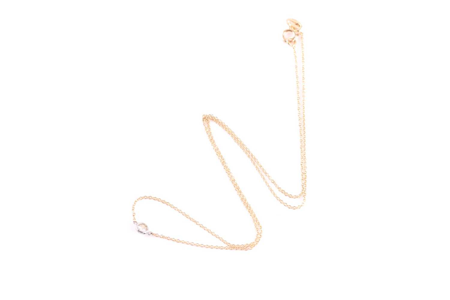 An 18ct yellow gold and diamond necklace, the chain set with a collet-mounted round brilliant-cut