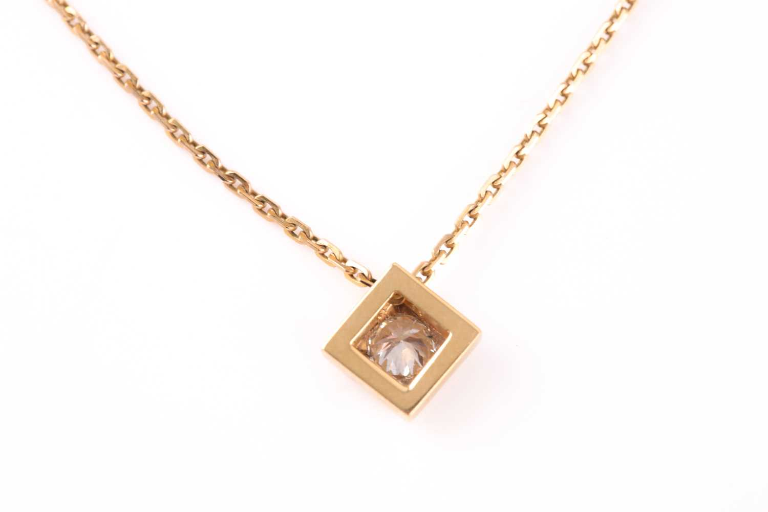 A solitaire diamond pendant, set with a round brilliant-cut diamond of approximately 0.33 carats, - Image 3 of 3