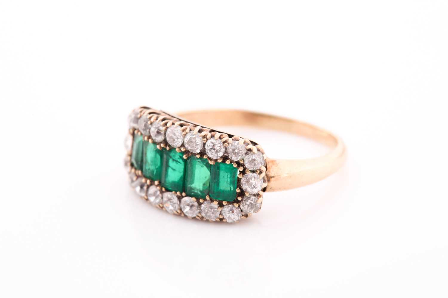 An emerald and diamond three row ring, set with a central line of slightly graduated emerald-cut - Image 5 of 6