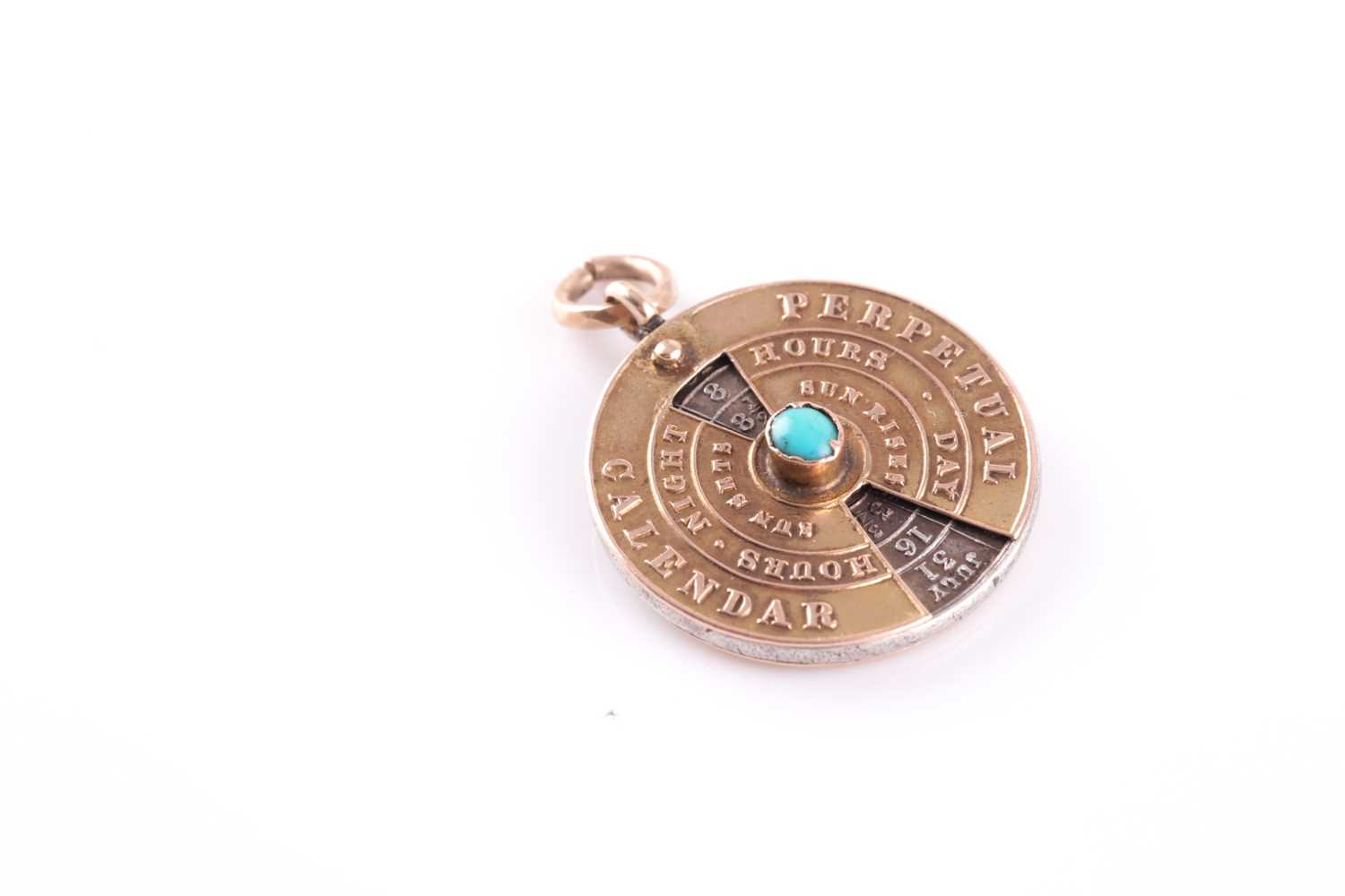 A 19th century yellow metal perpetual calendar pendant, with white metal central disk, featuring - Image 3 of 4