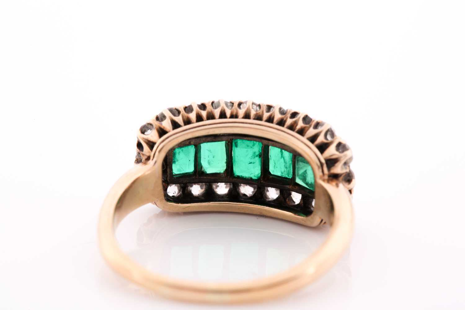 An emerald and diamond three row ring, set with a central line of slightly graduated emerald-cut - Image 4 of 6