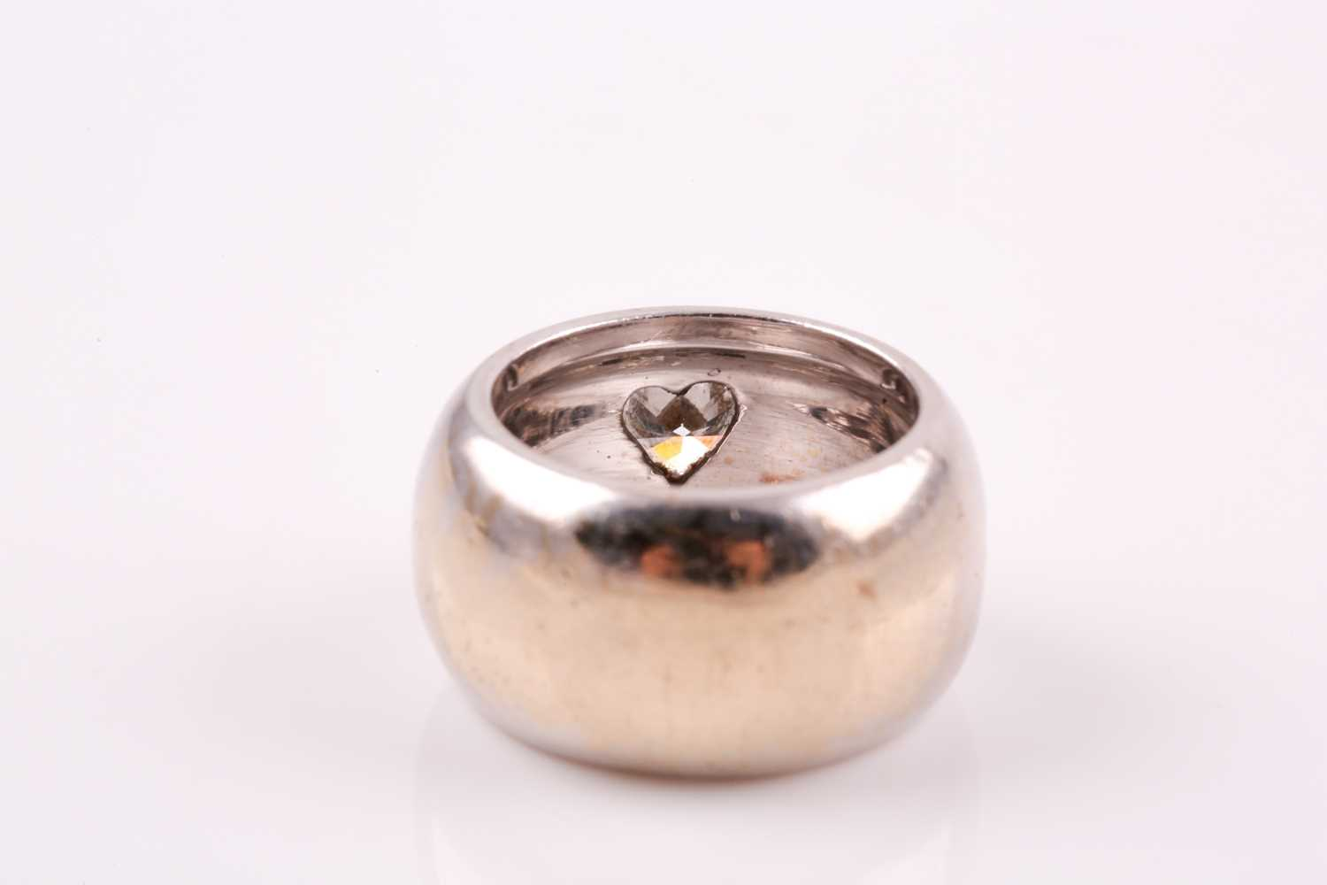 A single stone diamond dress ring, the heart-shaped diamond in raised rub-over mount within a wide - Image 4 of 6