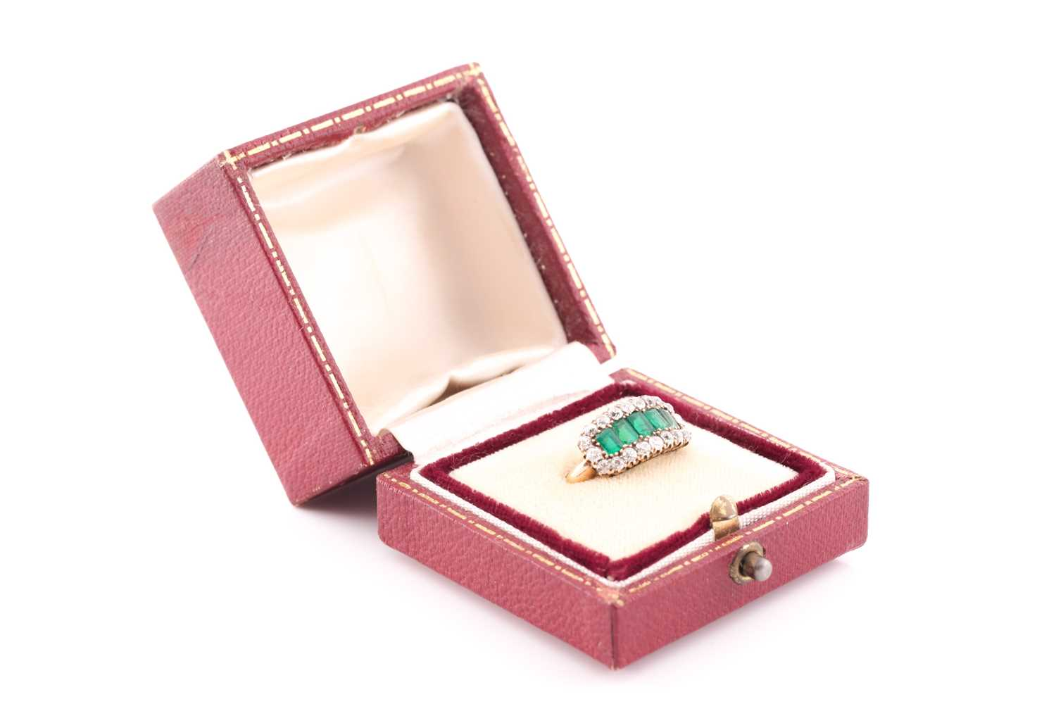 An emerald and diamond three row ring, set with a central line of slightly graduated emerald-cut - Image 3 of 6
