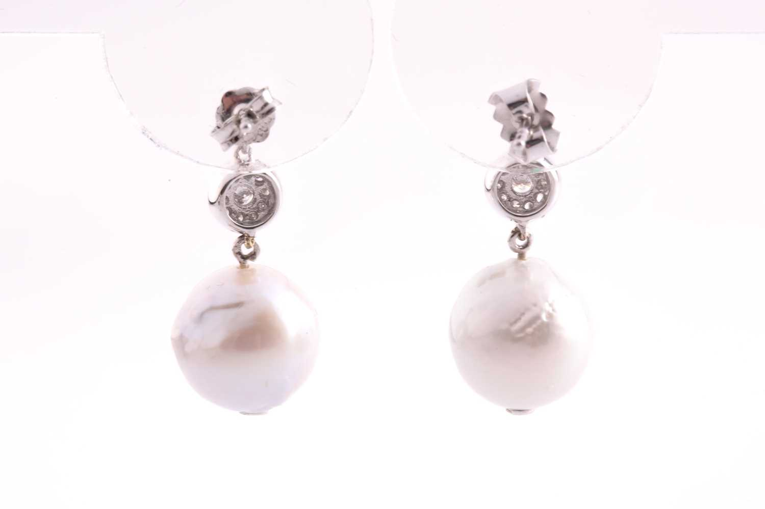 A pair of white gold, diamond, and pearl drop earrings, set with South Sea pearls, approximately - Image 2 of 2