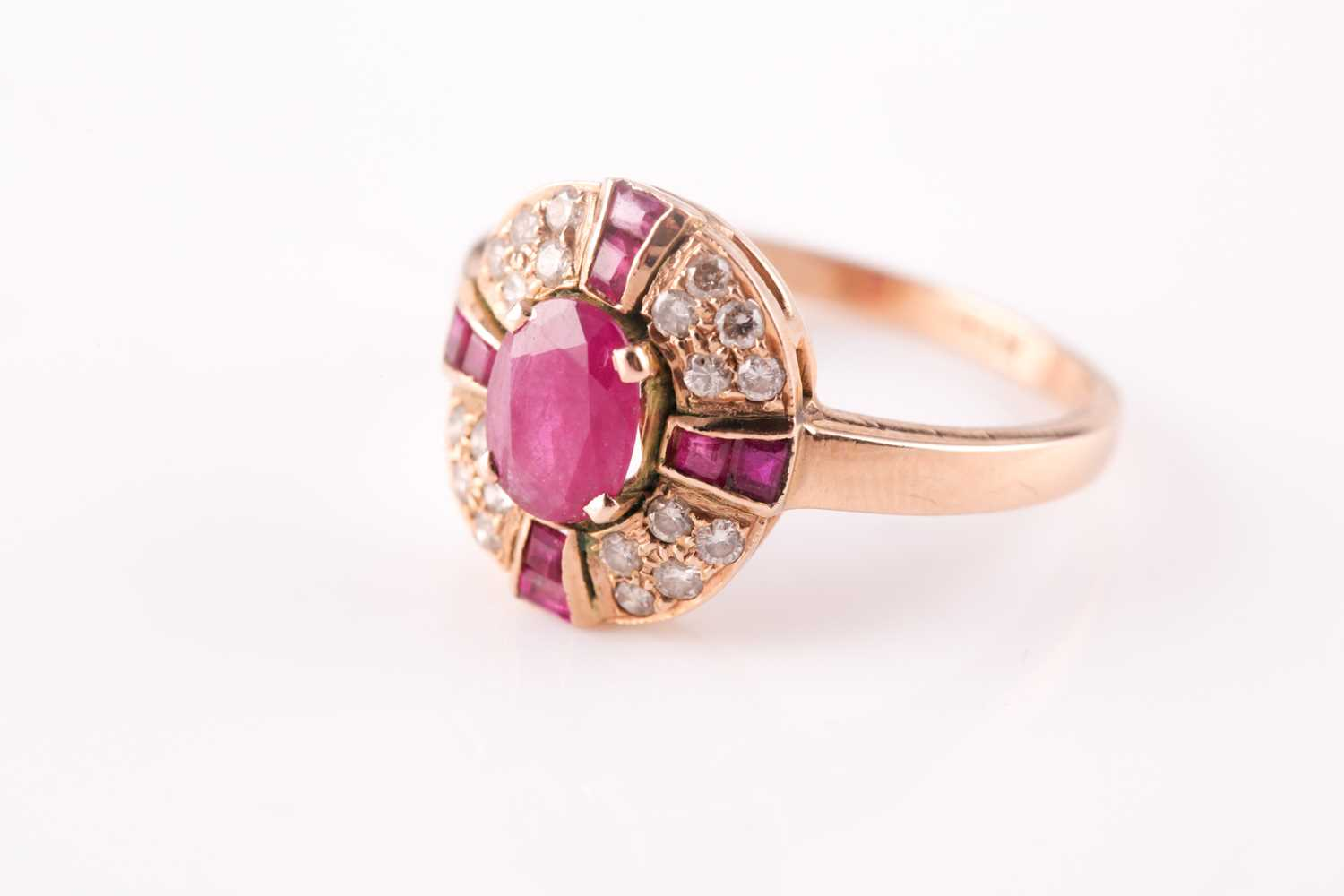 A ruby and diamond cluster ring, the central mixed oval cut ruby with a cruciform plaque of - Image 3 of 4