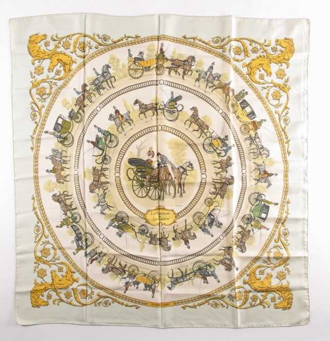 A Hermes silk square scarf printed with La Promenade De Longchamps pattern in yellow and tones of