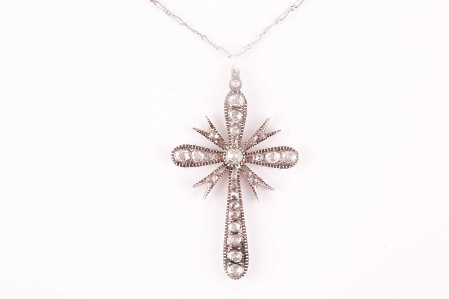A white metal and diamond cross pendant, set with mixed rose-cut diamonds, 4.5 x 2.9 cm, unmarked,