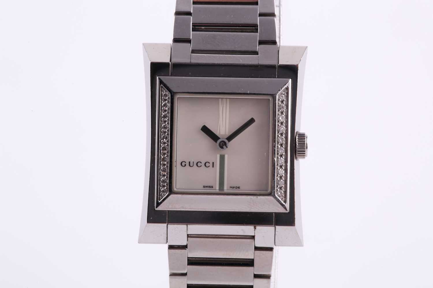 A ladies stainless steel watch by Gucci, with mother-of-pearl square dial, small diamonds set to - Image 7 of 10