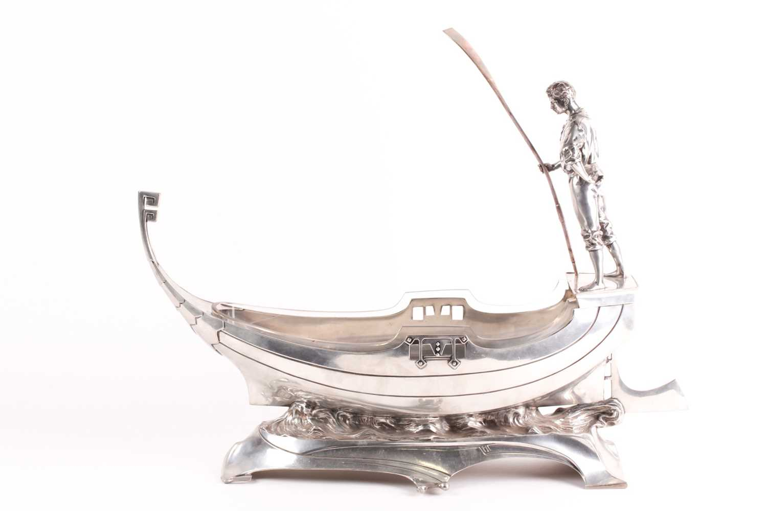 An Art Nouveau WMF centrepiece. In the form of a gondola with a gondolier to the rear holdng a pole;