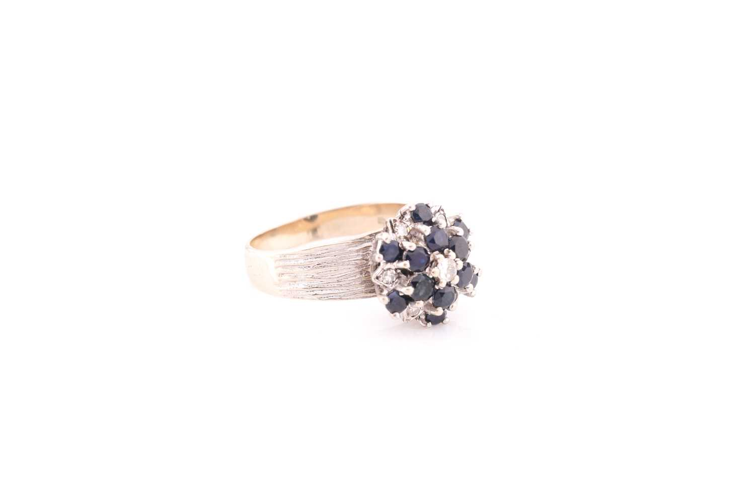An 18ct white gold, diamond, and sapphire cluster ring, set with a cluster of round-cut sapphires - Image 2 of 4