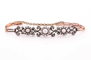 A late 19th / early 20th century diamond bracelet, set with three clusters of old-cut diamonds