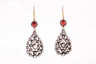 A pair of diamond and garnet earrings, the openwork pear-shaped silver mounts inset with rose-cut