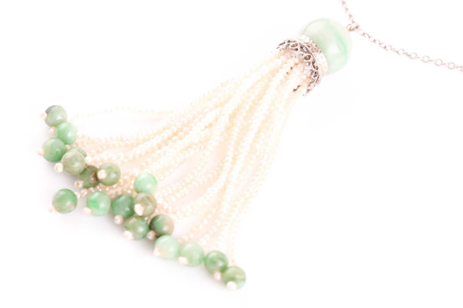 An Art Deco jade and seed pearl tassel pendant necklace, set with a rounded jade bead suspended with - Image 3 of 3