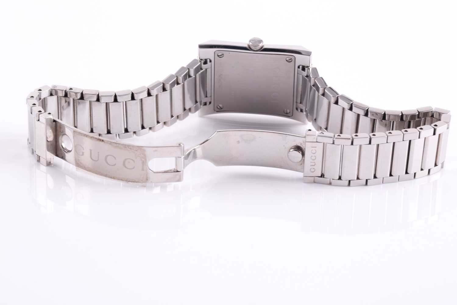 A ladies stainless steel watch by Gucci, with mother-of-pearl square dial, small diamonds set to - Image 5 of 10