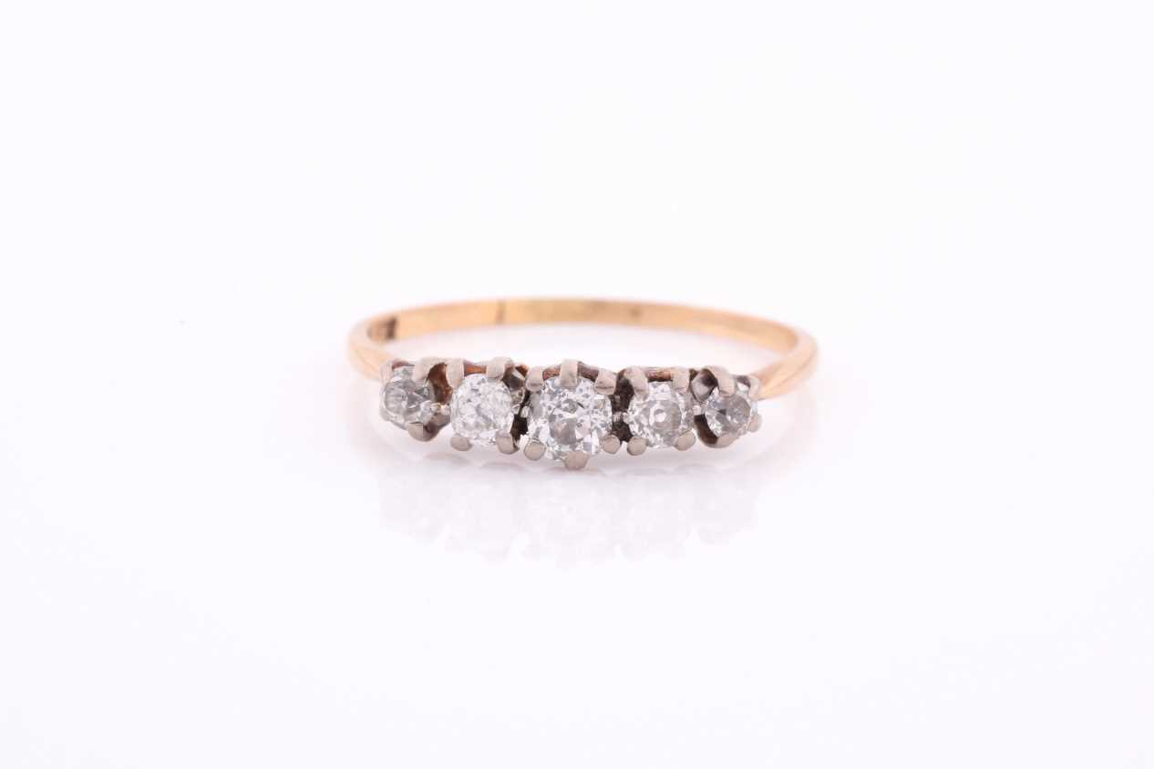 An 18ct yellow gold and diamond ring, set by five old-cut diamonds, the central stone of