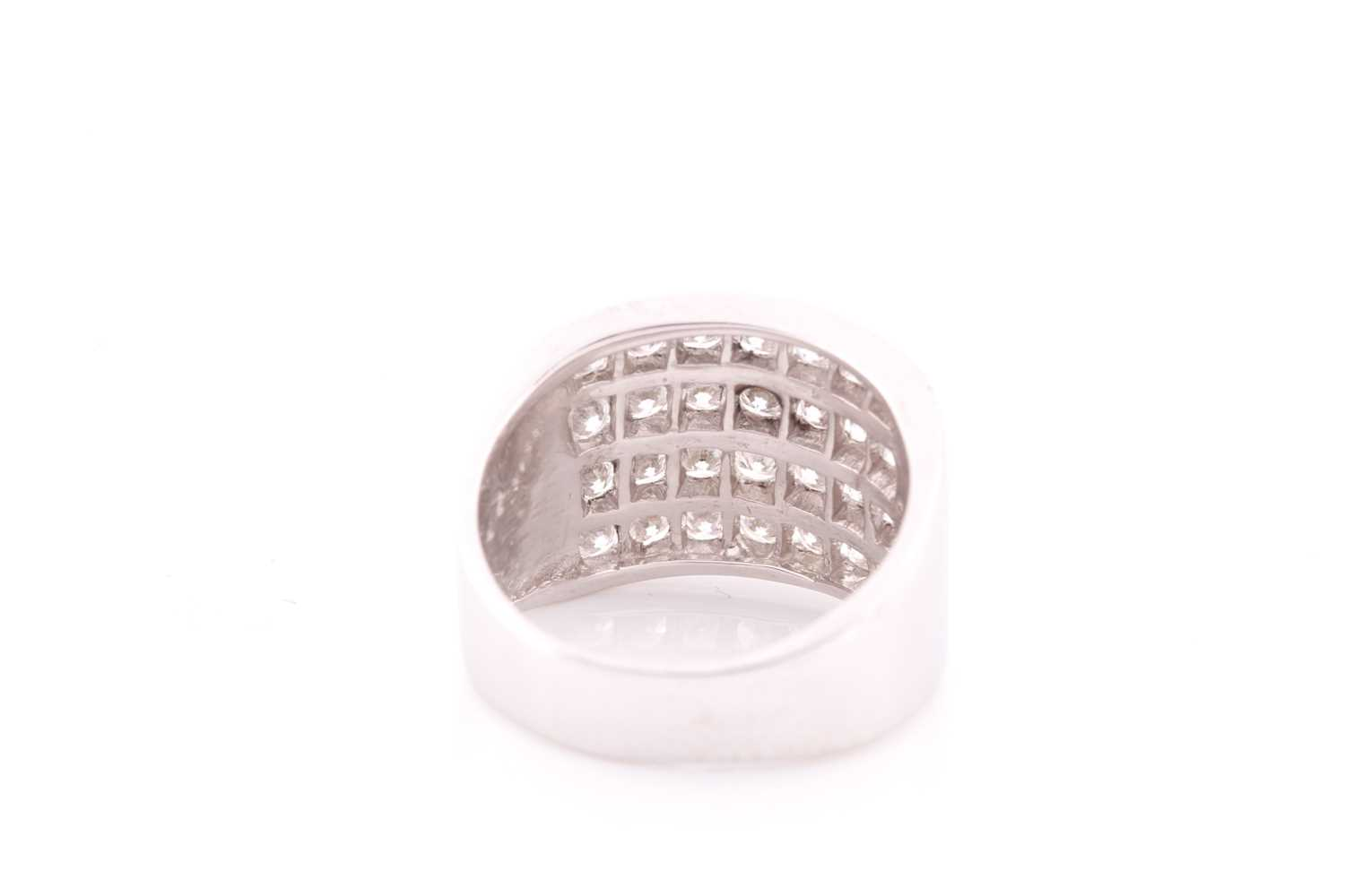 A diamond band ring, channel-set with four rows of round brilliant-cut diamonds of approximately 2. - Image 2 of 4
