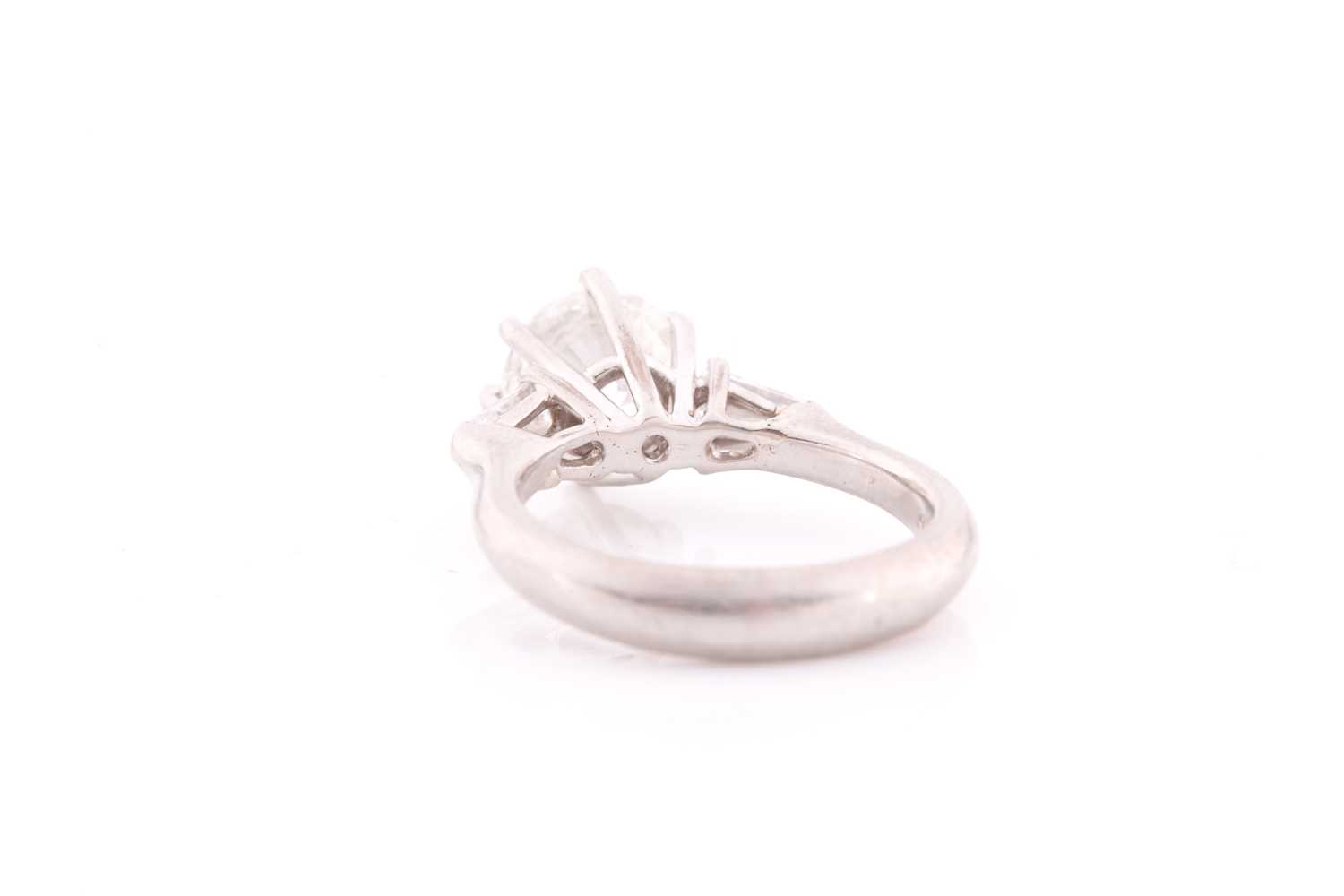 A platinum and diamond ring, set with a round brilliant-cut diamond of approximately 1.50 carats, - Image 2 of 4