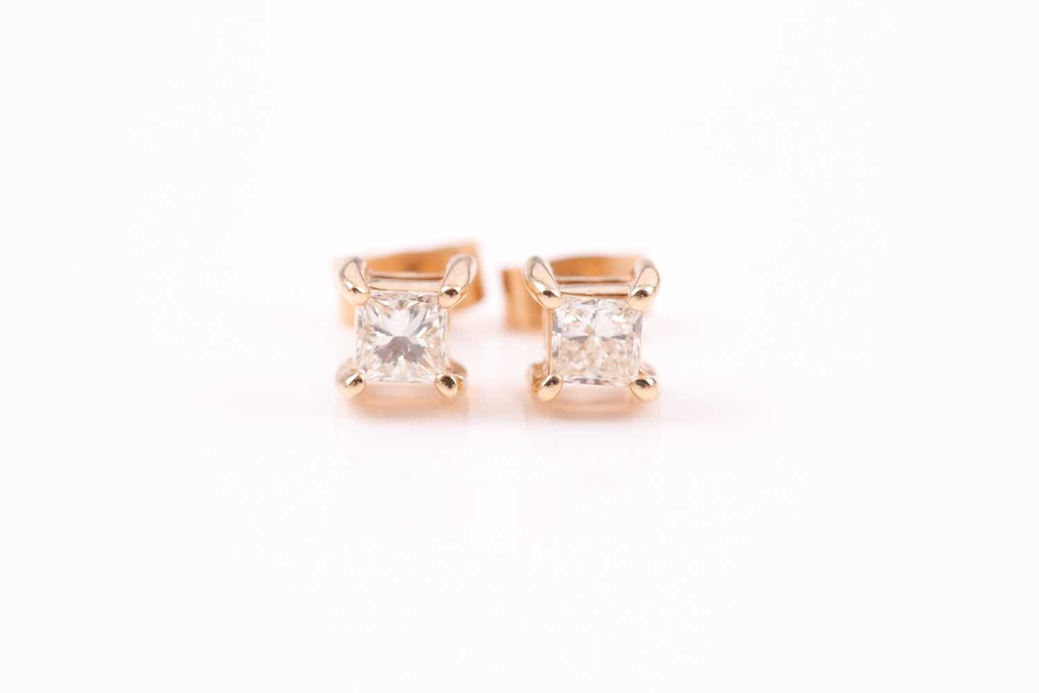 A pair of yellow metal and diamond earrings, set with square-cut diamonds of approximately 0.20