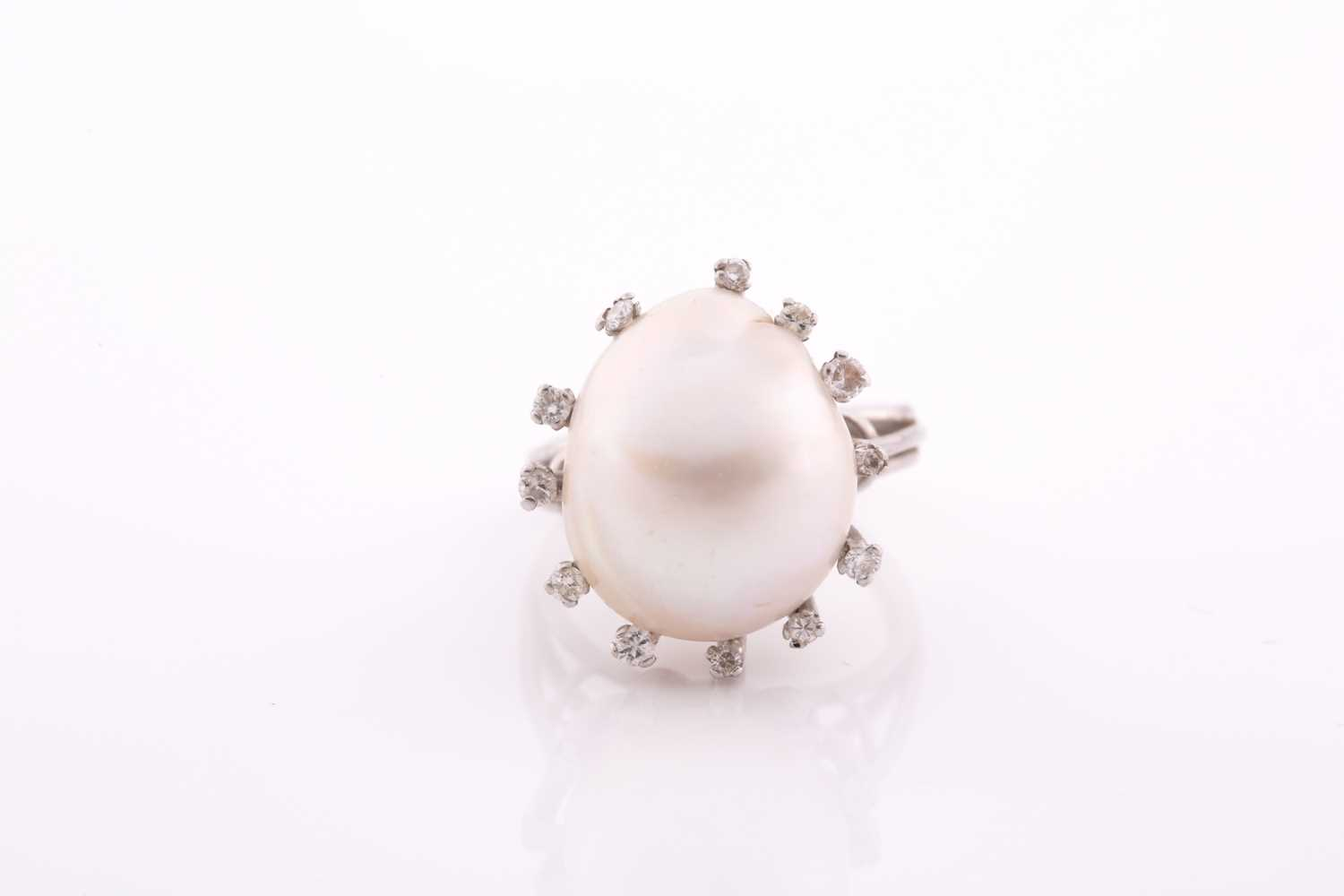 A diamond and cultured Baroque pearl cocktail ring, the pearl measuring approximately 1. 7x 1.35,