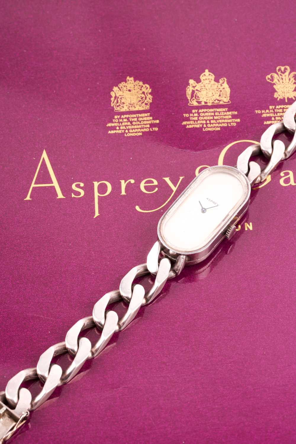 Asprey. A lady's silver wristwatch, the elongated oval brushed silvered dial with simple arrowhead - Image 6 of 18