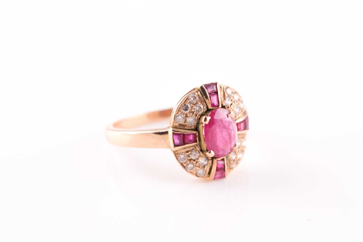 A ruby and diamond cluster ring, the central mixed oval cut ruby with a cruciform plaque of - Image 4 of 4