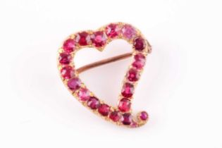 A yellow metal and red spinel heart-shaped brooch, set with mixed-cut red spinels, unmarked, 2.2 x